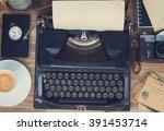 black vintage typewriter on... | Shutterstock . vector #391453714