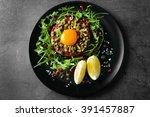beef tartare served in a round... | Shutterstock . vector #391457887