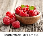 fresh raspberry in a wooden... | Shutterstock . vector #391474411