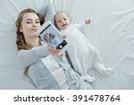 mother and little baby taking... | Shutterstock . vector #391478764