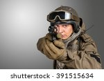 soldier pointing gun at you | Shutterstock . vector #391515634