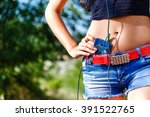 belly girl in denim shorts with ... | Shutterstock . vector #391522765