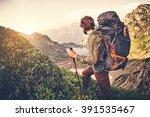 man traveler with backpack... | Shutterstock . vector #391535467