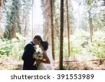 bride and groom in a park... | Shutterstock . vector #391553989