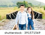 young asian thai boy and girl... | Shutterstock . vector #391571569
