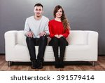 Stock photo shy woman and man sitting on sofa couch next to each other first date attractive girl and 391579414
