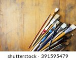 row of artist paintbrushes... | Shutterstock . vector #391595479
