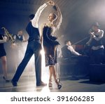 dance couple dancing to a live... | Shutterstock . vector #391606285