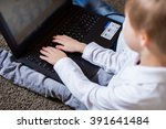 children sit with a laptop on... | Shutterstock . vector #391641484