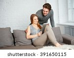 young couple watching photos on ... | Shutterstock . vector #391650115