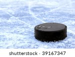 black hockey puck on ice rink | Shutterstock . vector #39167347