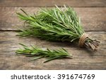 rosemary bound on a wooden board | Shutterstock . vector #391674769