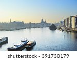 Stock photo skyline of amsterdam with amstel river at sunset netherlands 391730179