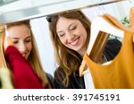 portrait of two beautiful young ... | Shutterstock . vector #391745191