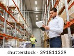 Small photo of wholesale, logistic, people and export concept - businessman or supervisor with clipboards at warehouse
