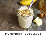 banana smoothie with oat in a... | Shutterstock . vector #391816981