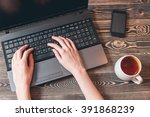 woman typing on laptop | Shutterstock . vector #391868239