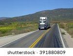 semi truck driving on highway ... | Shutterstock . vector #391880809