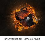 briefcase burning in fire | Shutterstock . vector #391887685