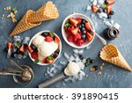 Stock photo vanilla ice cream scoops with fresh berries overhead shot 391890415