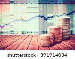 coin stack on old wooden floor... | Shutterstock . vector #391914034