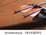 An archery bow and arrows on a...