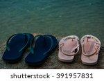 flip flops on a sandy ocean...   Shutterstock . vector #391957831