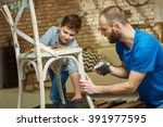father and son tinkering at... | Shutterstock . vector #391977595