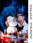 Small photo of Portrait of a crazy medieval scientist working in his laboratory. Alchemist. Halloween.
