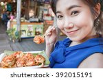 cute girl of asian happy to eat ... | Shutterstock . vector #392015191
