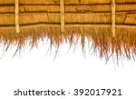 A Thatch Roof On White...