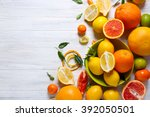 Various Citrus Fruits On Woode...