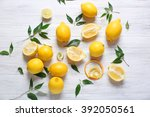 Pile of lemons on wooden table