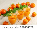 three tangerine cocktails with... | Shutterstock . vector #392058391