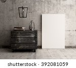 empty canvas poster on rustic... | Shutterstock . vector #392081059