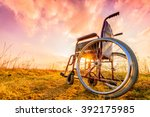 empty wheelchair on the meadow... | Shutterstock . vector #392175985