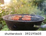 raw beef burgers sizzling on a... | Shutterstock . vector #392195605