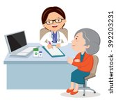 female doctor with senior woman.... | Shutterstock .eps vector #392203231