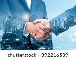 double exposure of handshake... | Shutterstock . vector #392216539