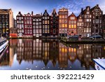 Stock photo amsterdam canal view at night reflection of houses at water 392221429