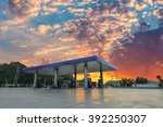 gas station at sunset. | Shutterstock . vector #392250307