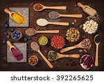 super foods in spoons and bowls ... | Shutterstock . vector #392265625