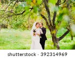 the groom is kissing the bride...   Shutterstock . vector #392314969