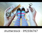 Stock photo alice in wonderland background key and potion in hands against a floor 392336767