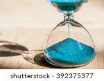 sand running through the bulbs... | Shutterstock . vector #392375377