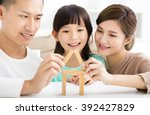 happy family playing with toy... | Shutterstock . vector #392427829
