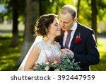 beautiful bride and groom in...   Shutterstock . vector #392447959