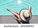 beautiful woman sunbathing by... | Shutterstock . vector #392460967