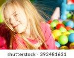 little smiling girl playing...   Shutterstock . vector #392481631