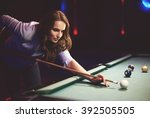 woman playing pool game in the... | Shutterstock . vector #392505505
